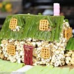 The Family Guy house made of caramel popcorn and decorated with pretzels, red and green licorice, graham crackers.