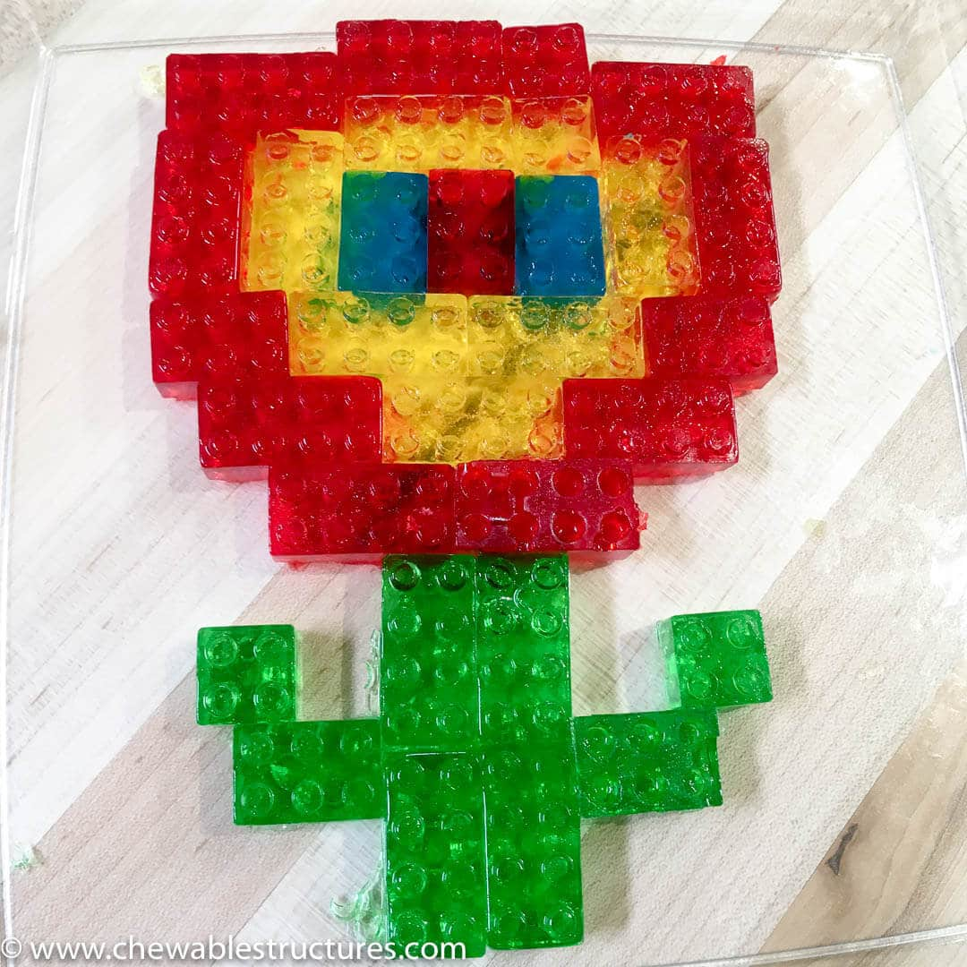 A colorful fire flower made of lego gummies.
