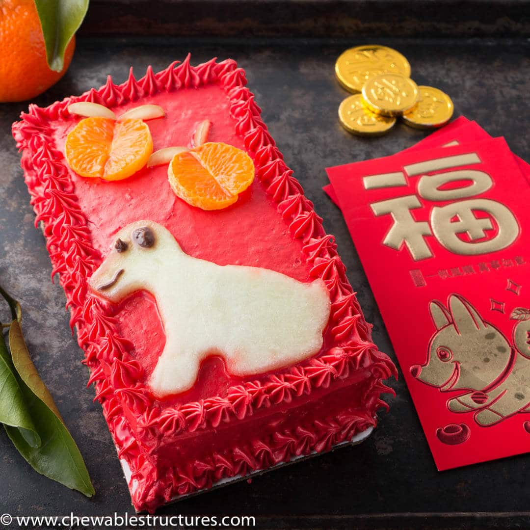 Vanilla cake decorated to look like a red envelope to celebrate Chinese New Year.