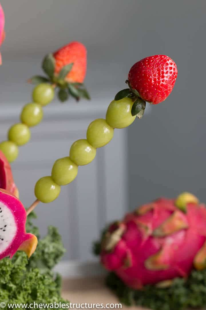 strawberry, green grapes on a skewer